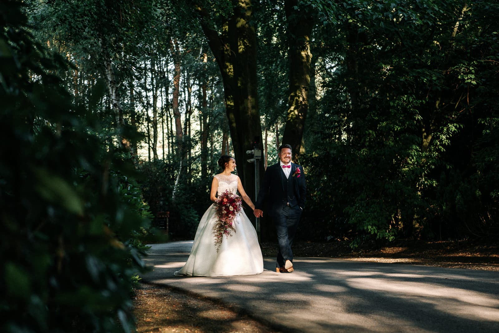 bride and groom walking in the sun