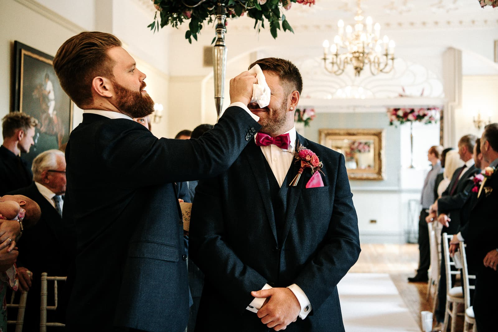 best man dabbing down the groom