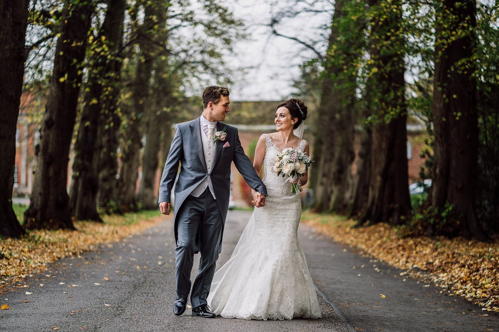 Bride and groom walking at Mottram Hall