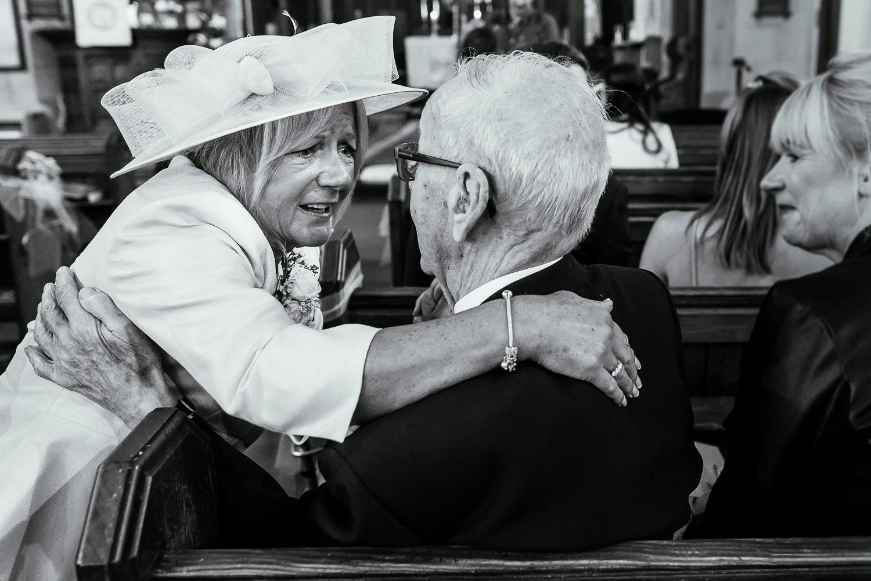 Brides mum hugging a guest