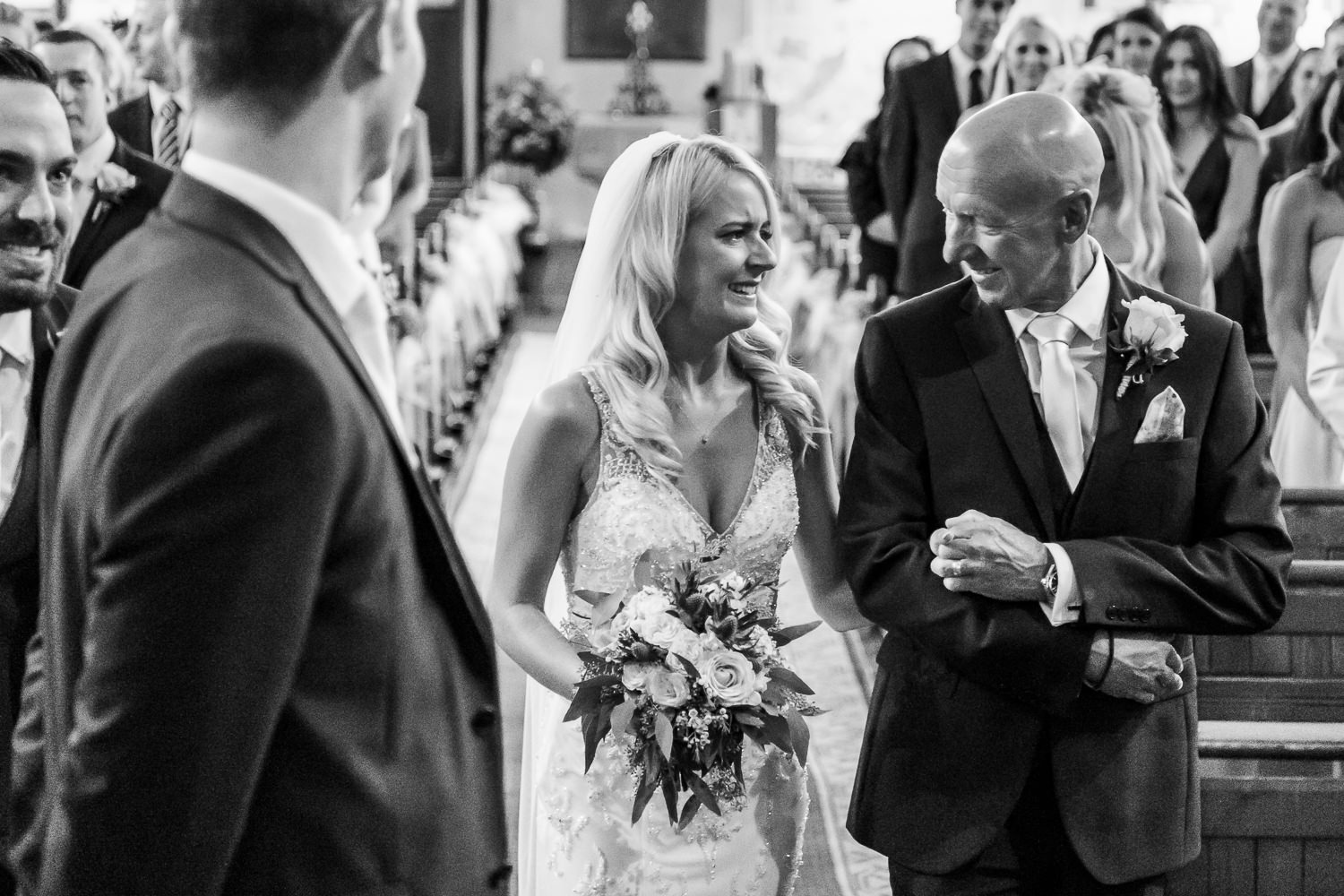 Bride and her dad looking at each other in the church
