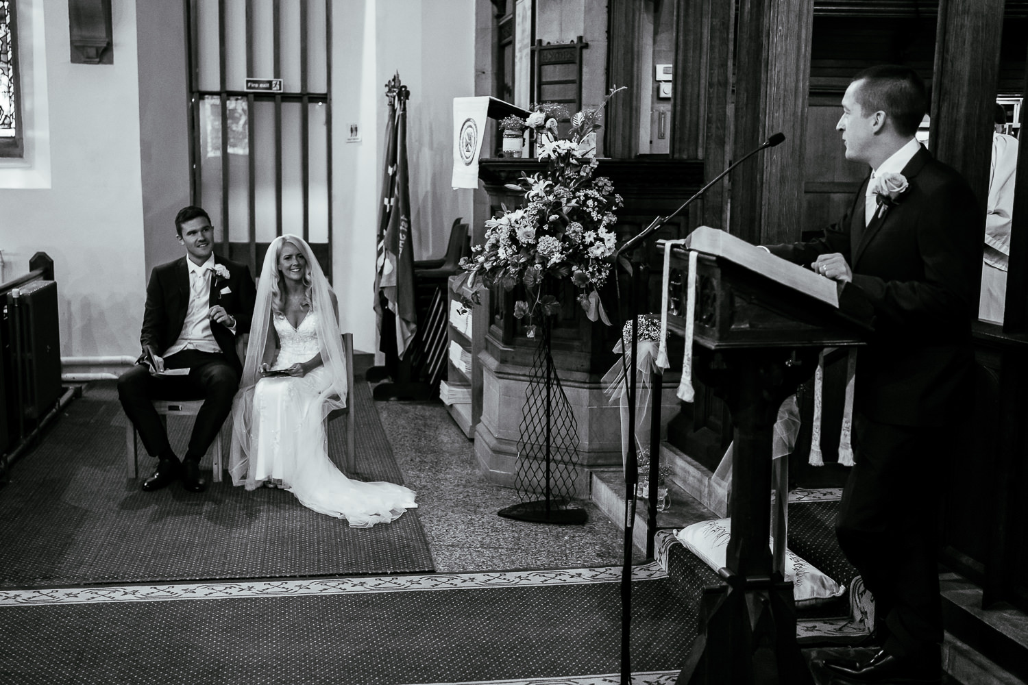 Bride and groom looking at a reader