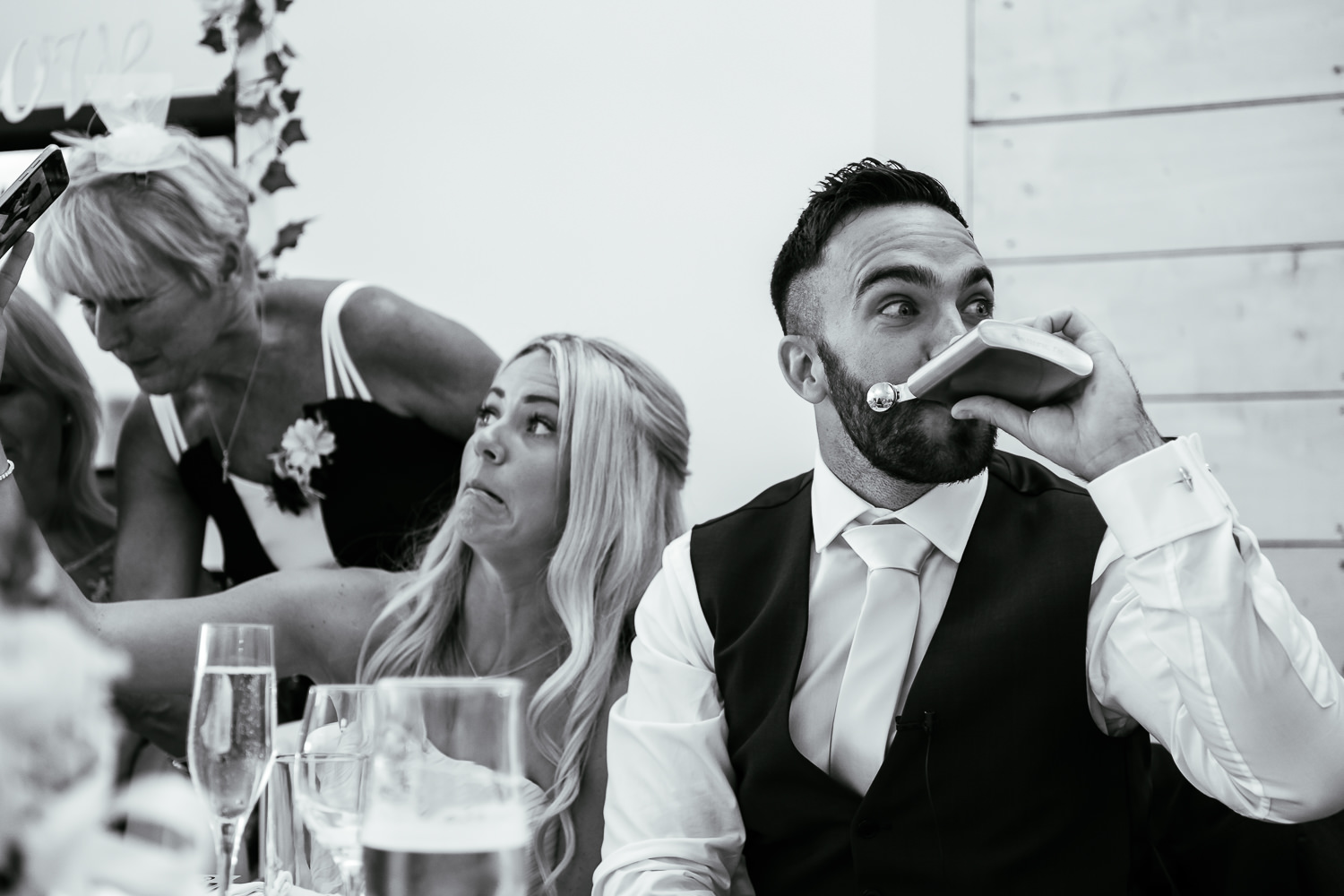 Groomsman drinking out of a whiskey bottle