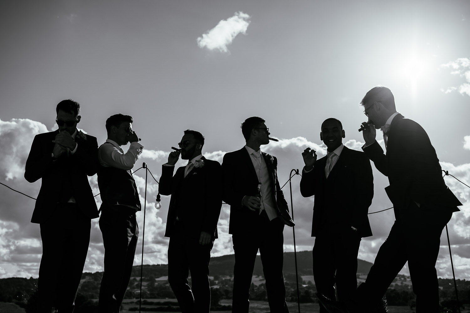 Groomsmen smoking out the decking of Bashall Barn