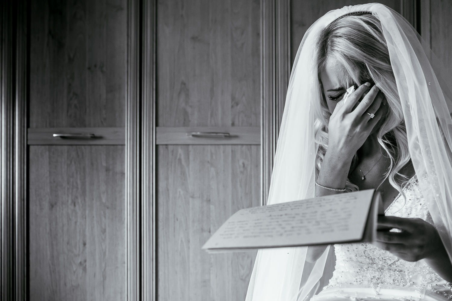 bride crying reading a letter
