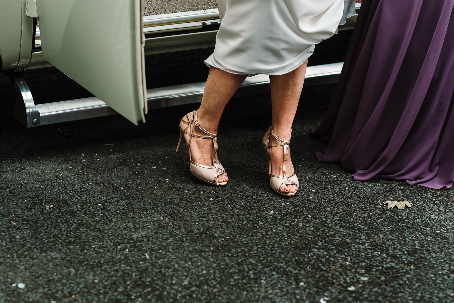 Brides shoes as she gets out of the car