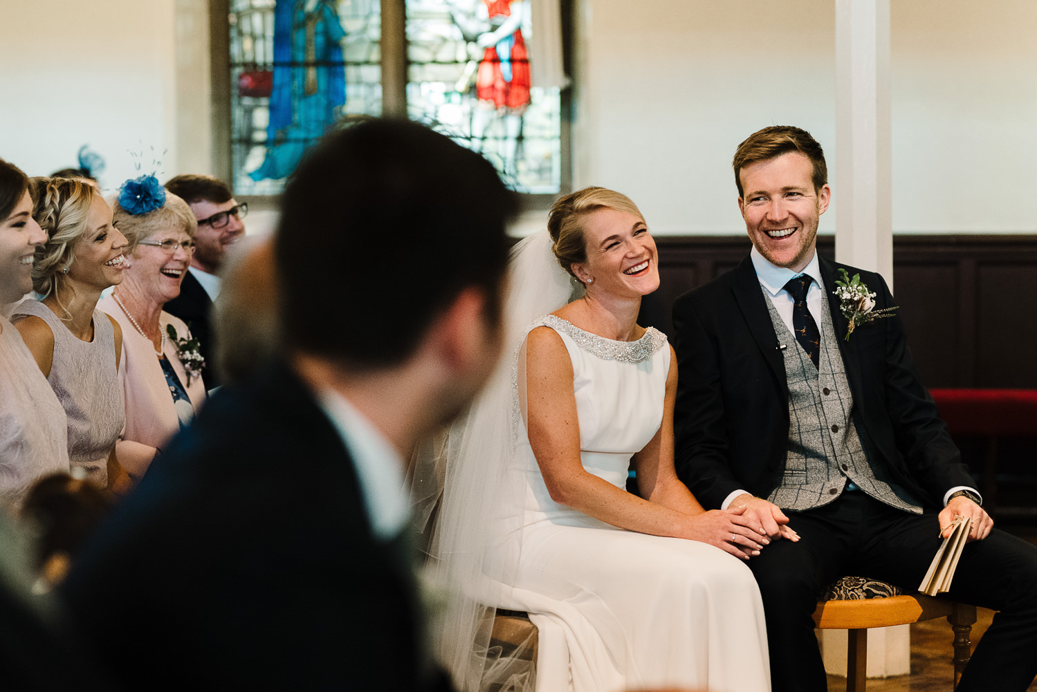 Bride and groom laughing at the best man