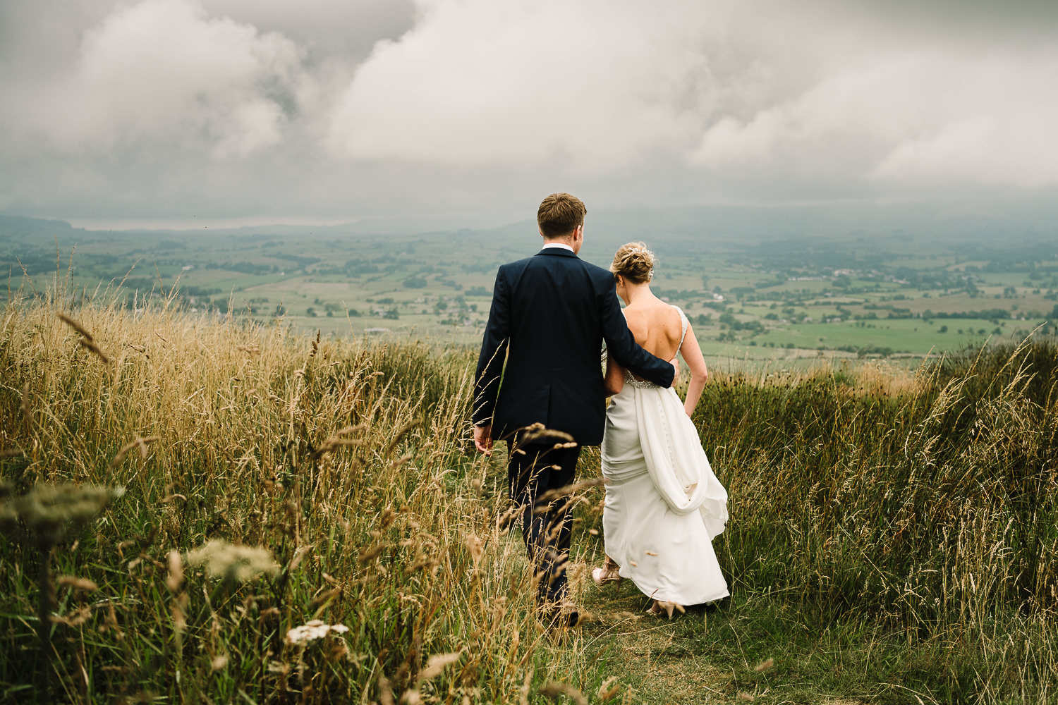 Bride and groom walking in the Ribble Valley