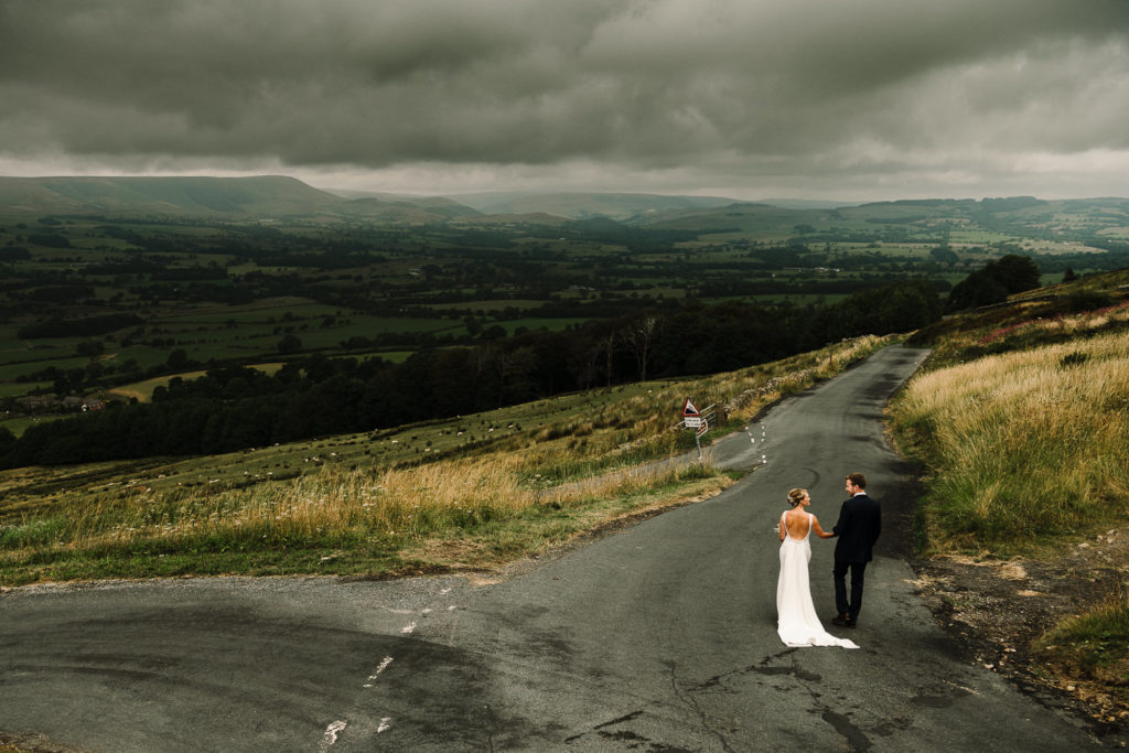 Bride and groom walking looking out to the Ribble Valley