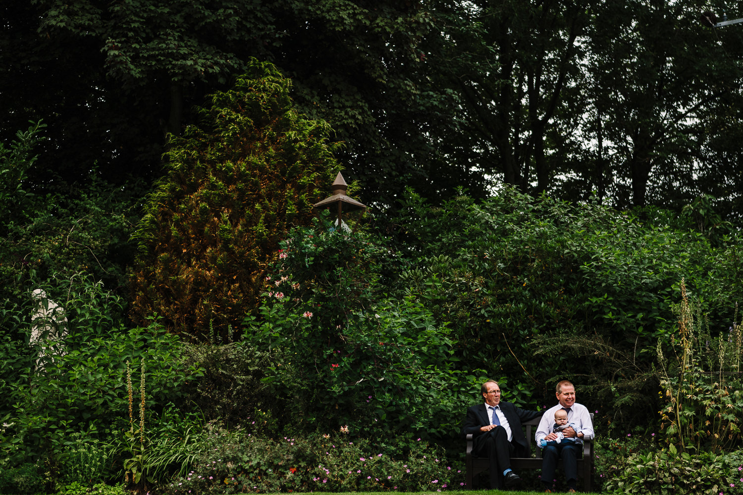 Two guests sitting on a bench