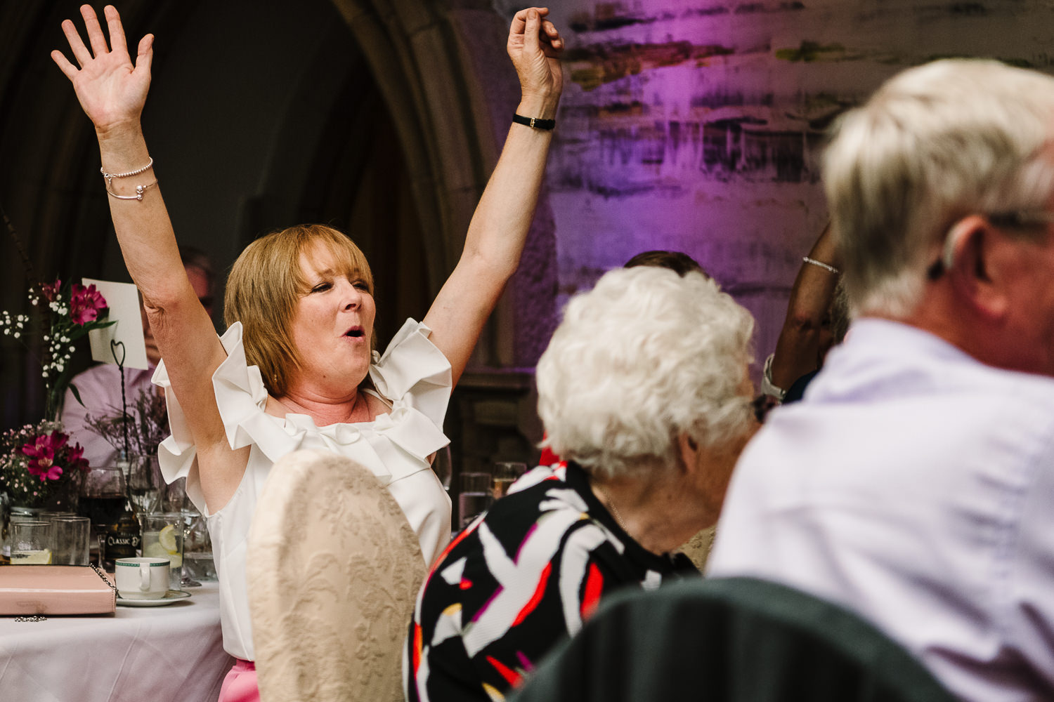 Guest with arm in the air shouting