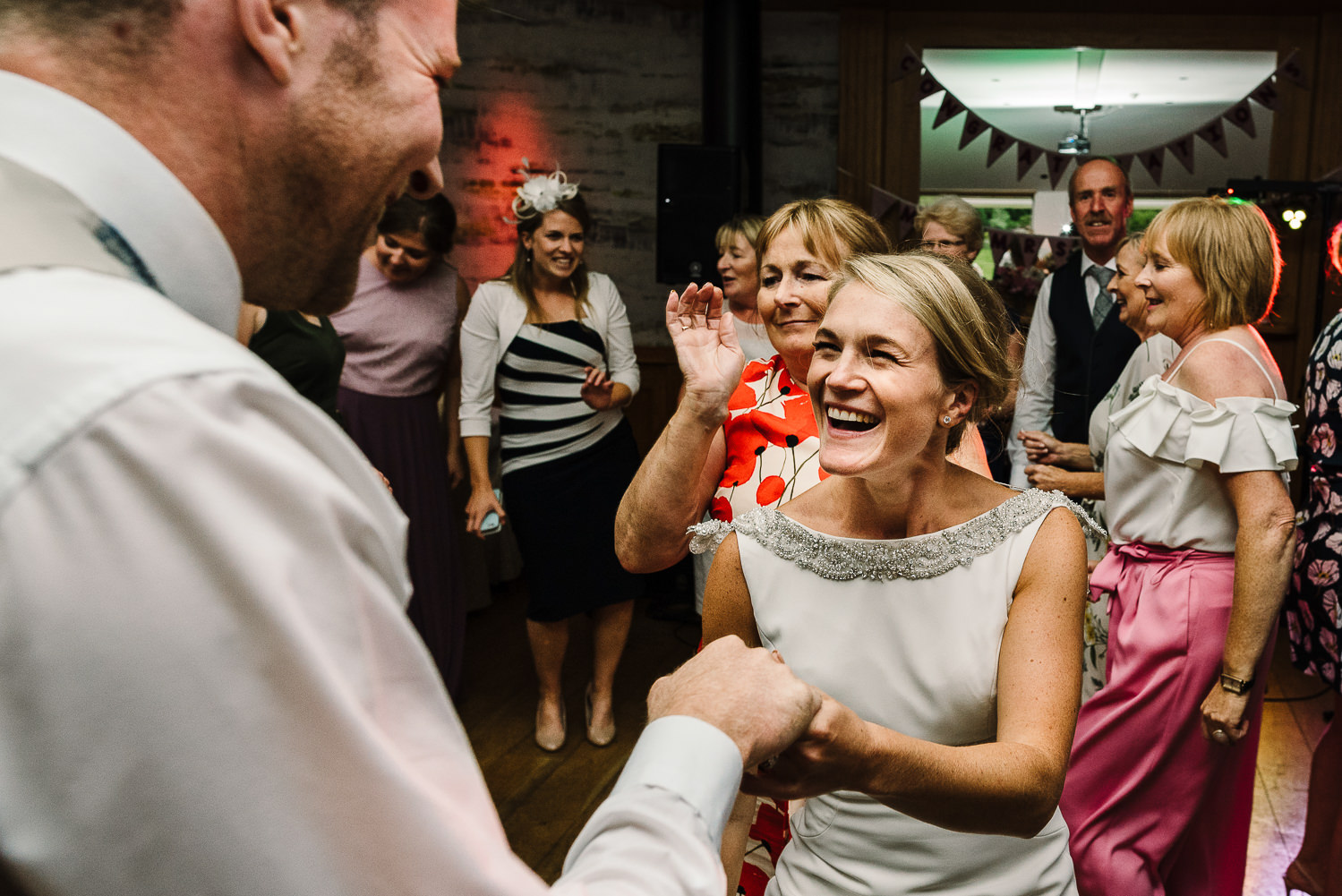 Bride and groom with guests dancing