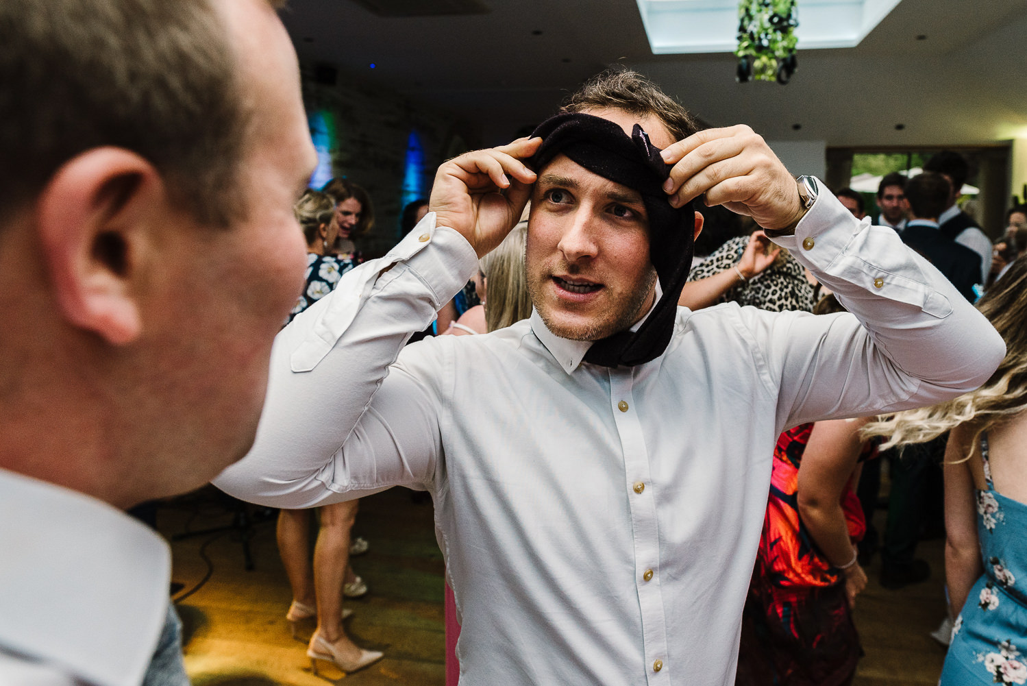 Man with tie around his head dancing