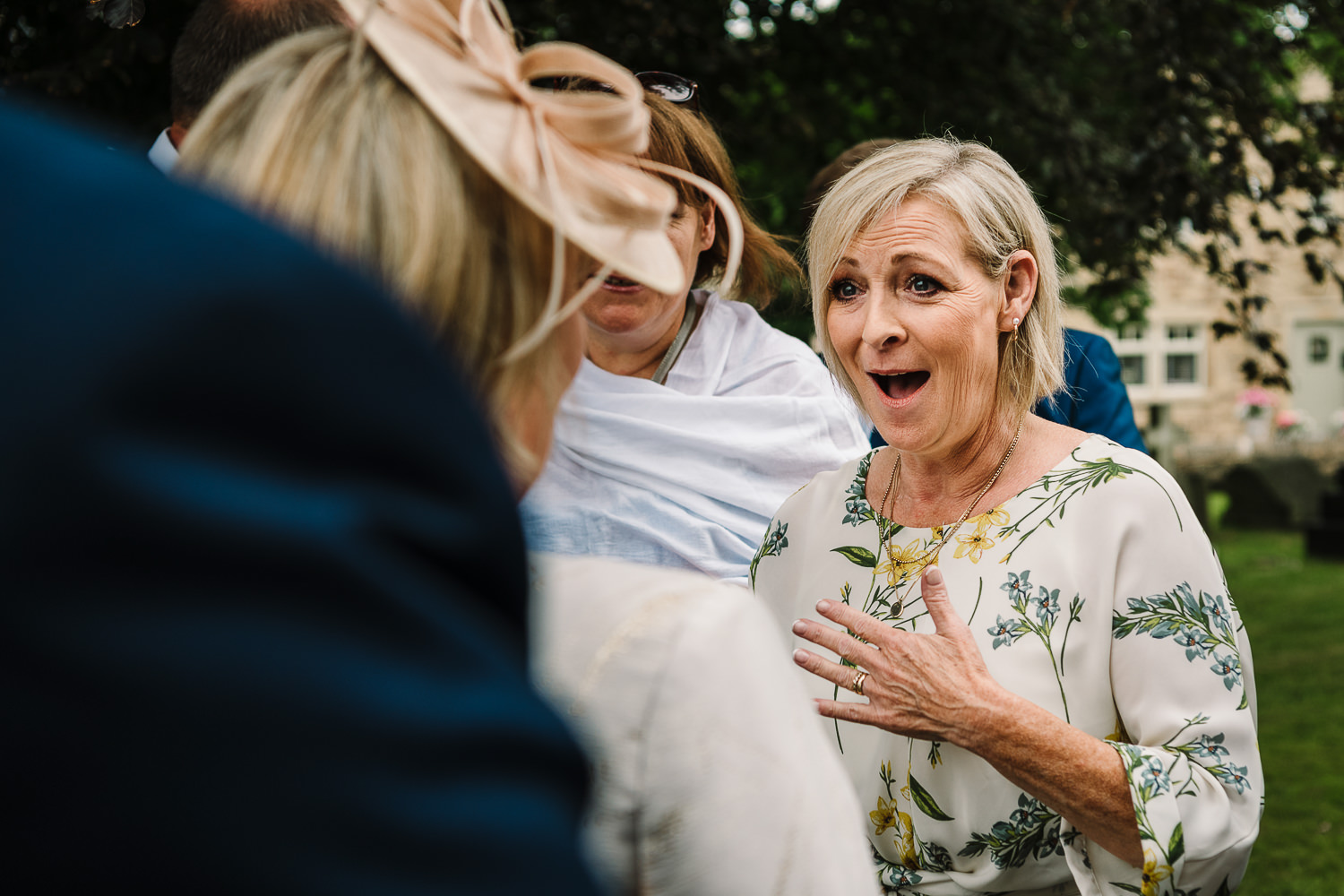 Guests laughing before the church