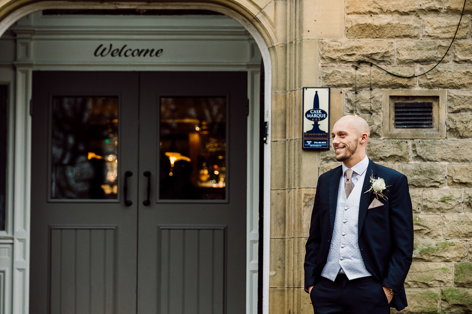 Groom waiting outside the pub