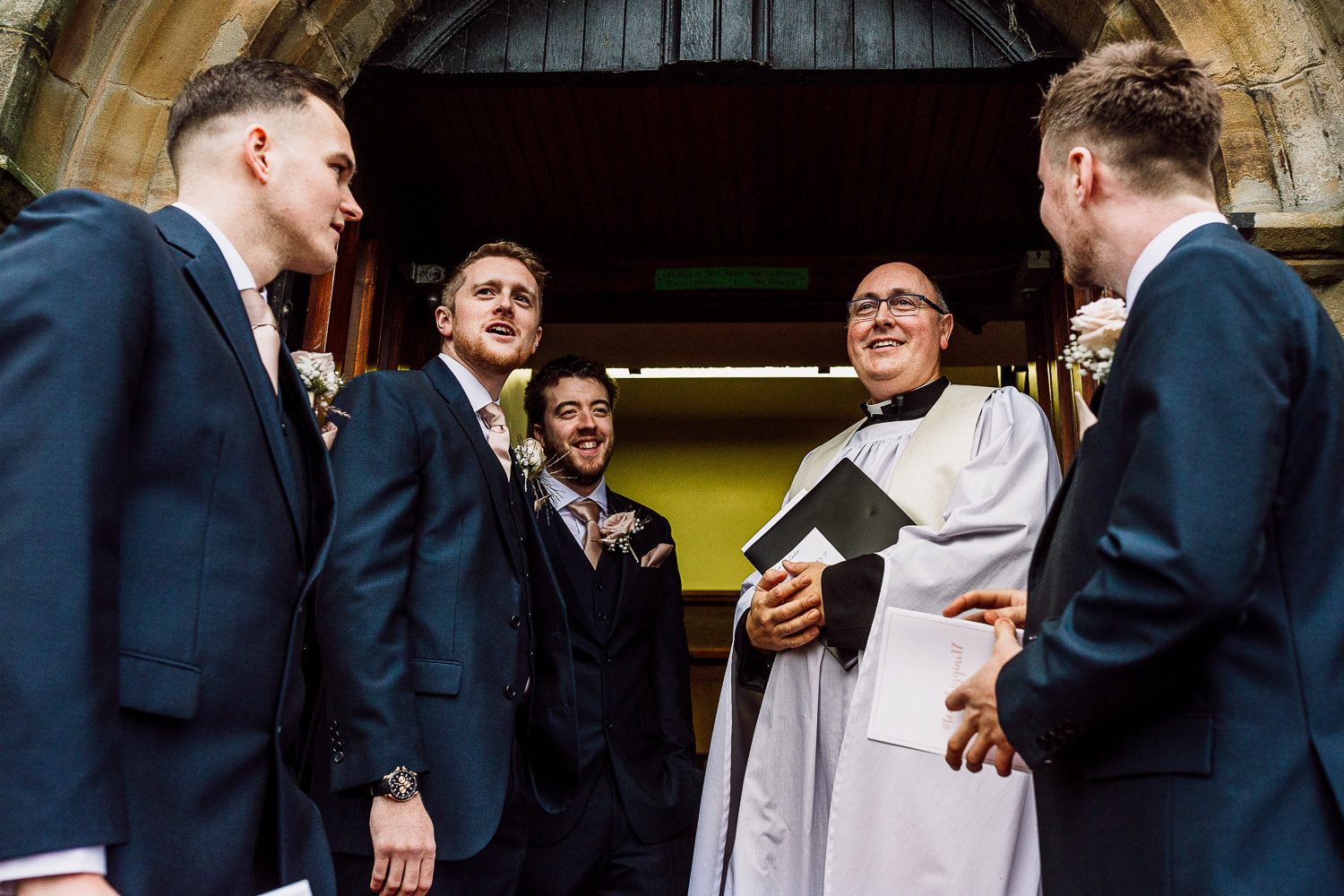 Groomsmen and vicar waiting