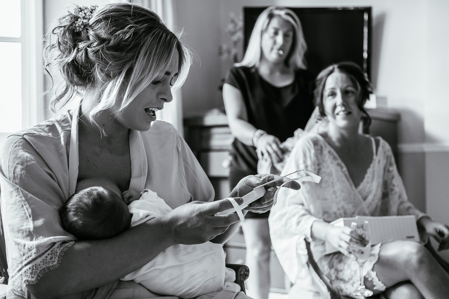 Bridesmaid breastfeeding and getting a gift