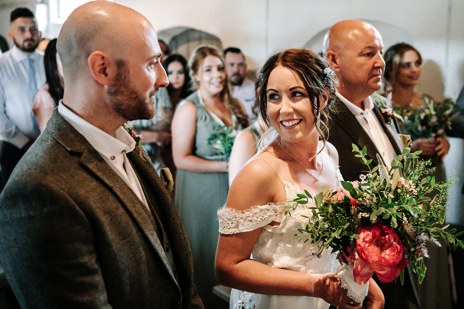 Bride seeing groom and smiling
