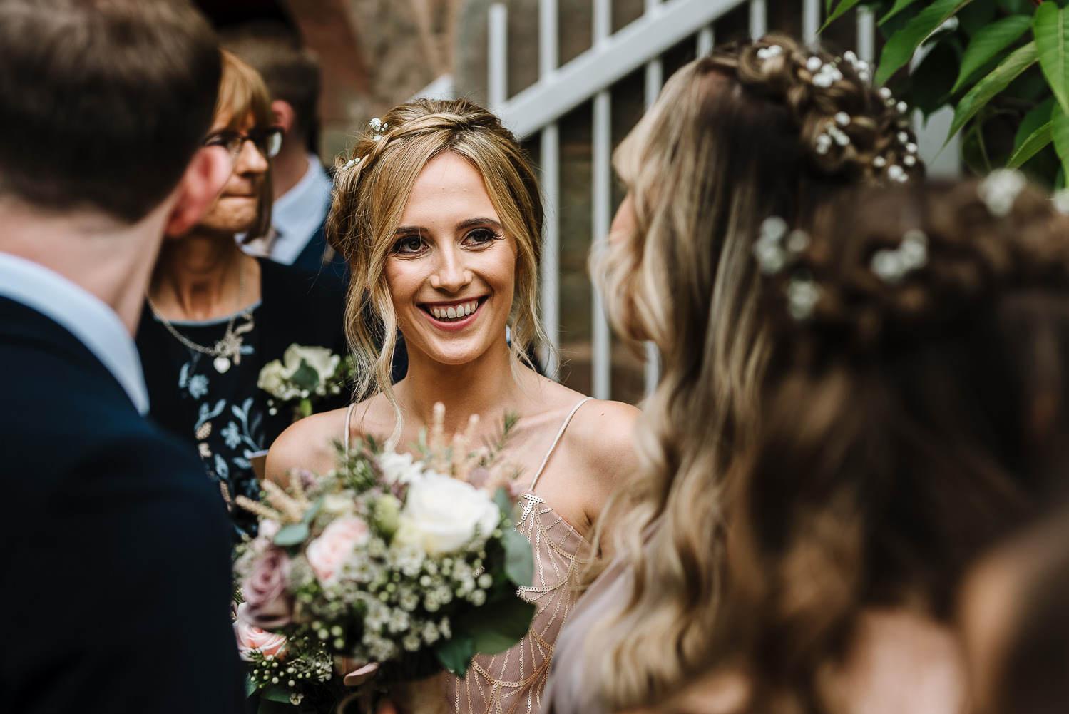 Brides sister smiling