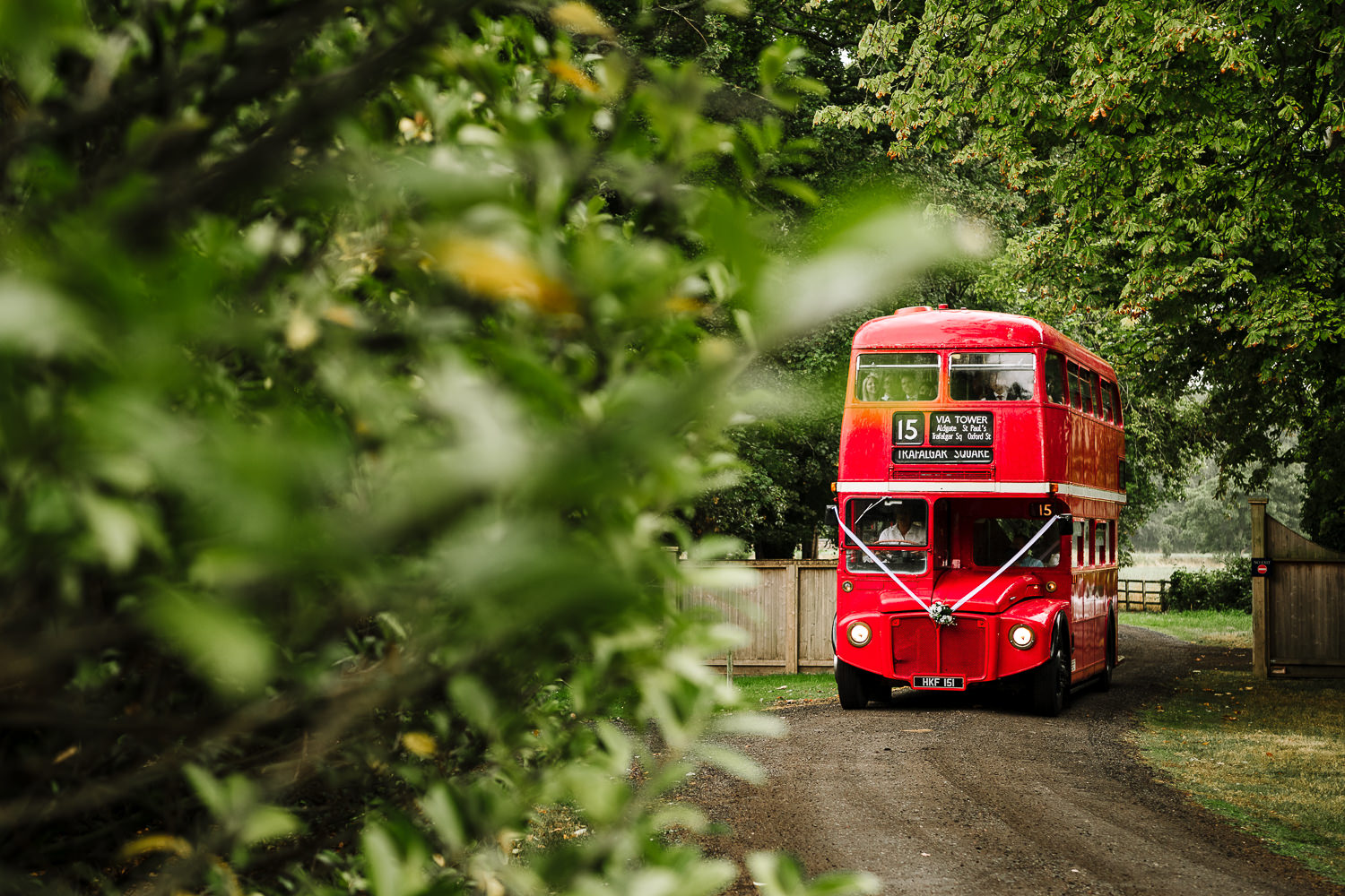 Wedding guests arriving by vintage bus