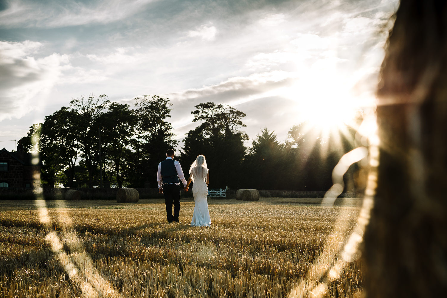 Bride and groom with sun set at Thornton Manor
