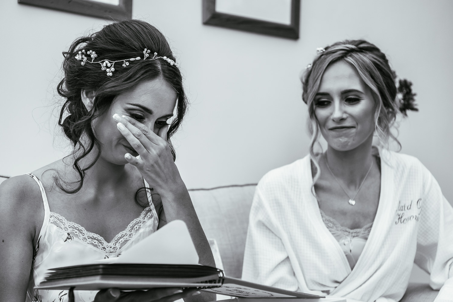 Bride crying reading a book from her sister