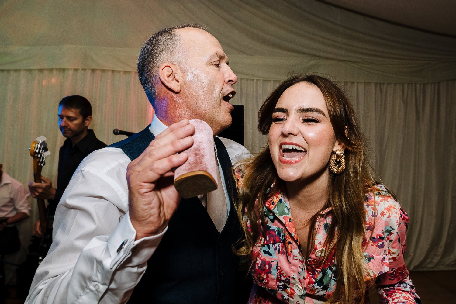 Father of bride dancing with a guest