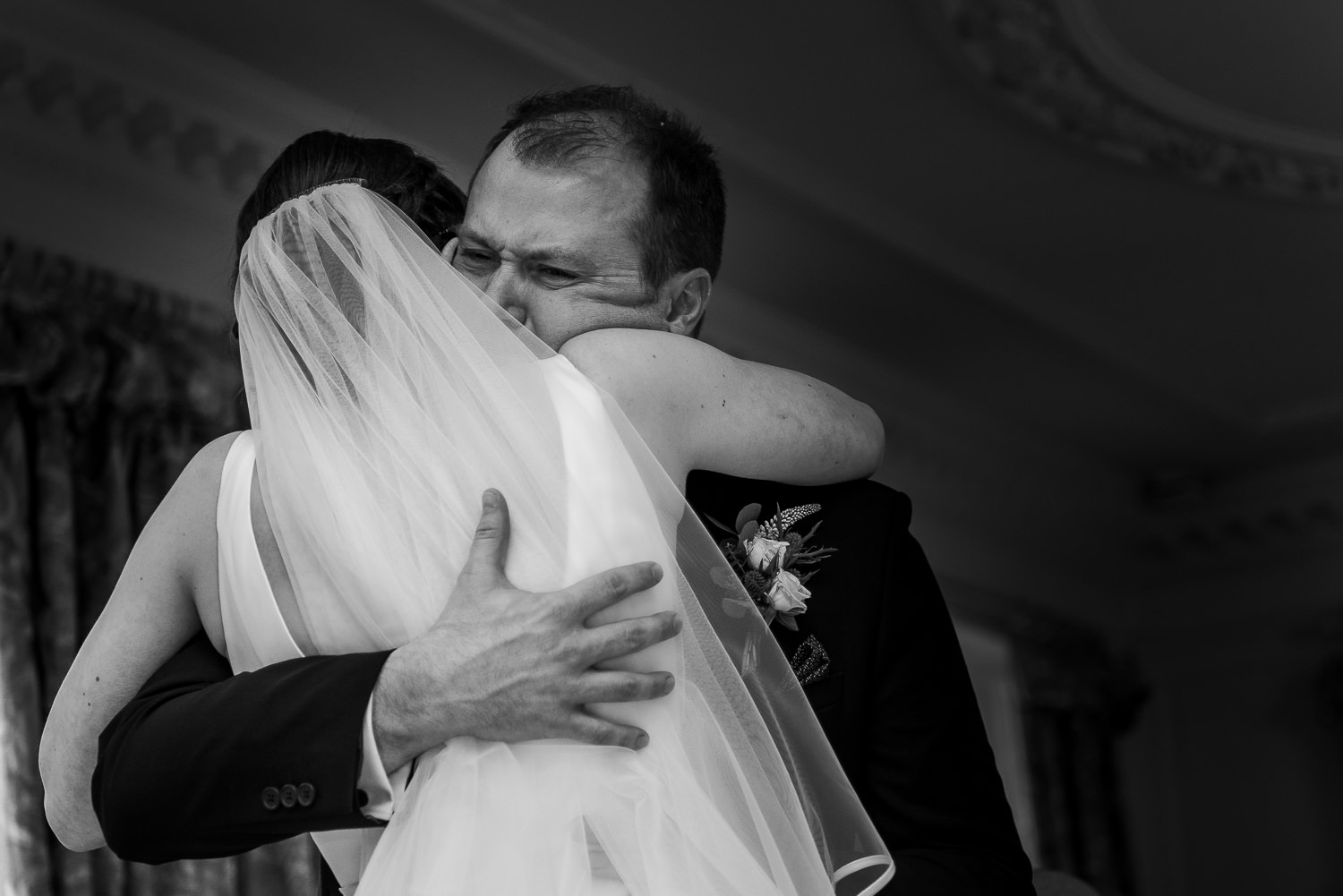 groom hugging his bride