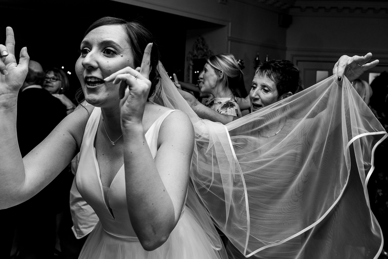 bride dancing with her mum holding her veil