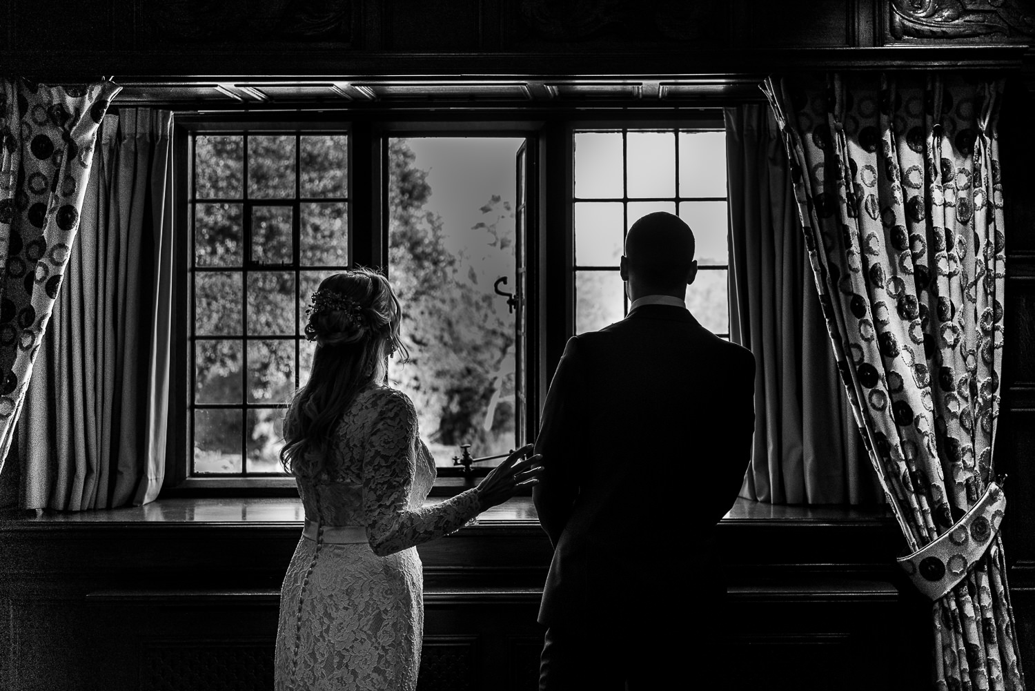 Bride and her son looking out the window