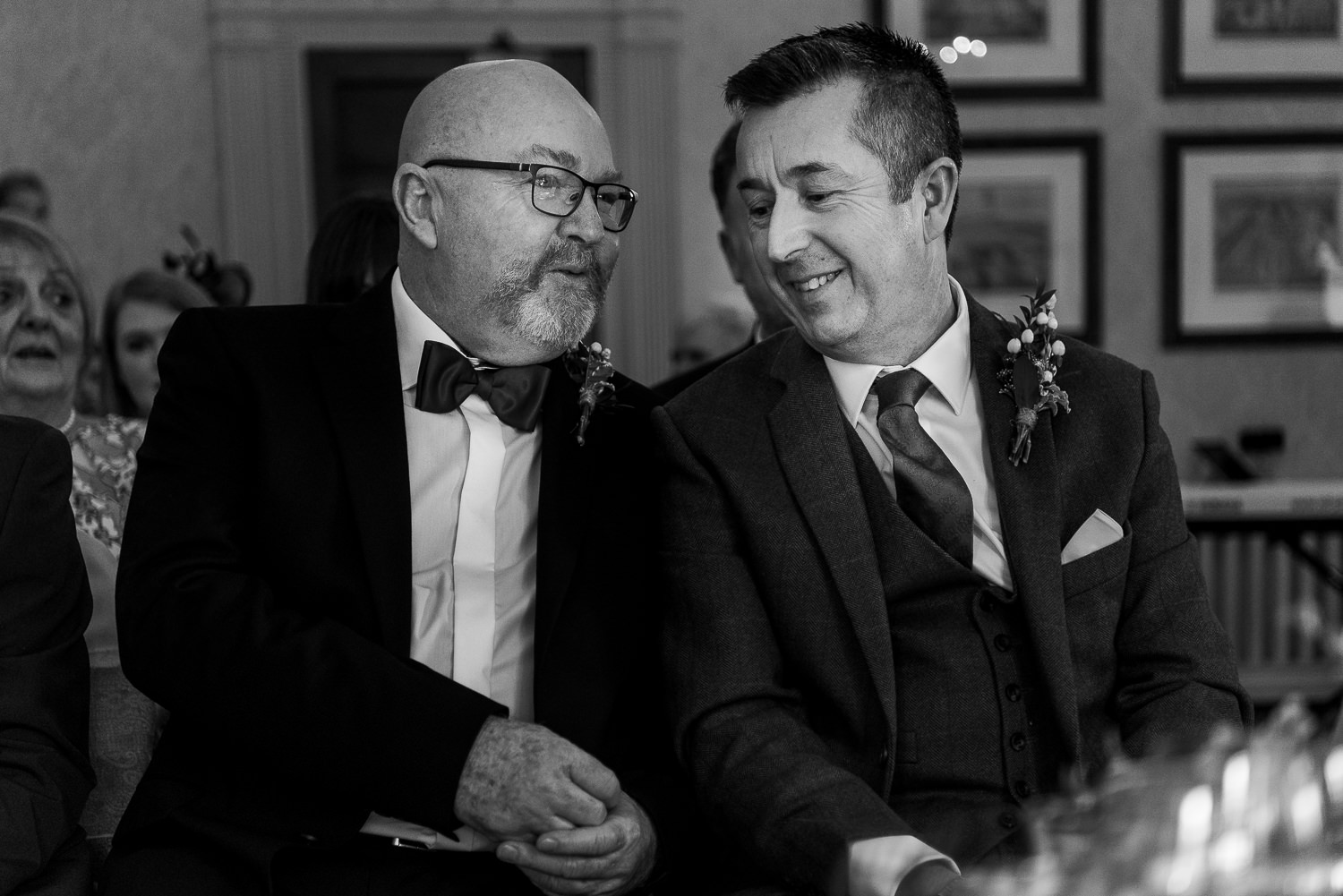 Groom and his best man waiting and laughing