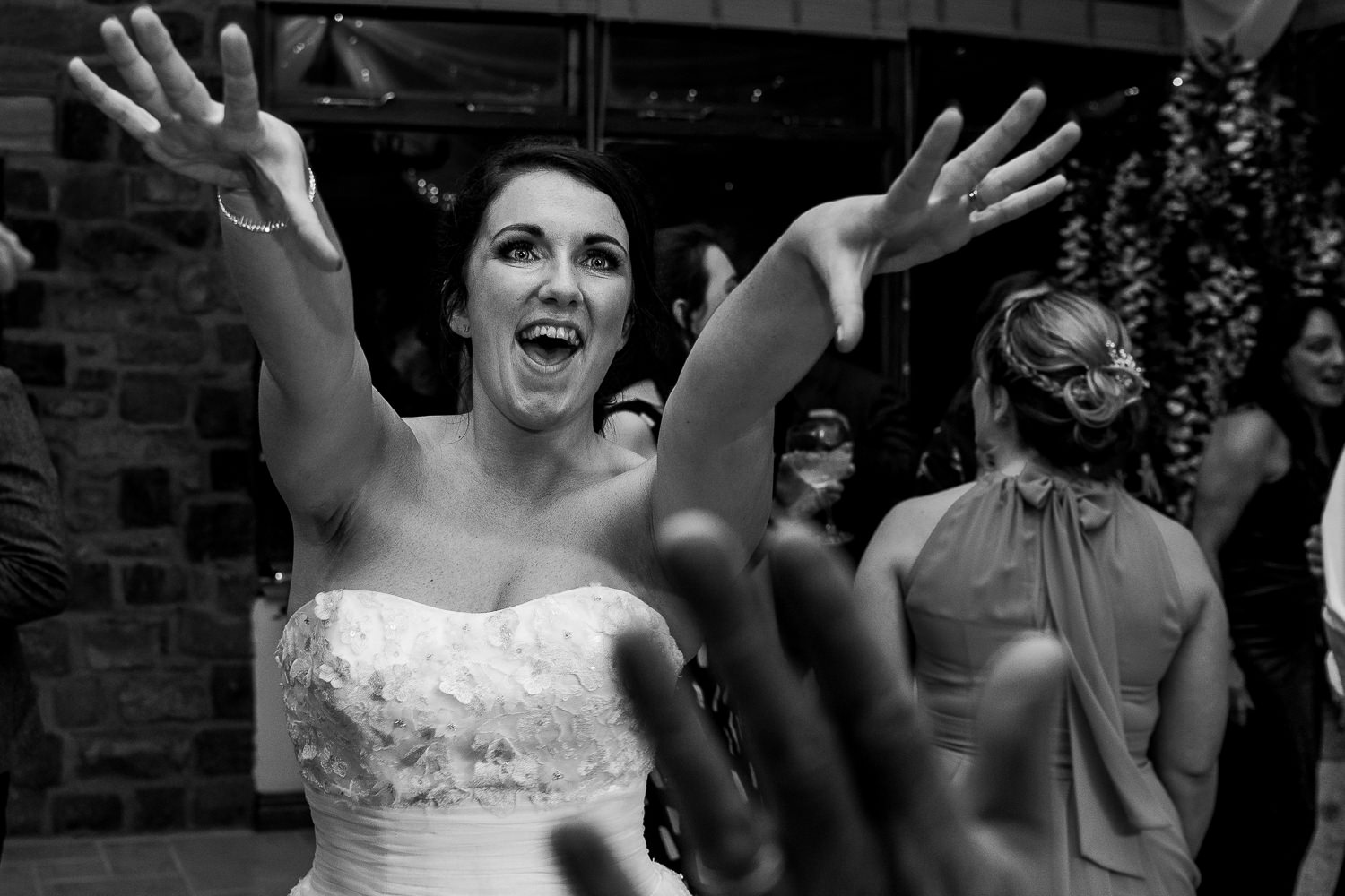 bride with her hands in air