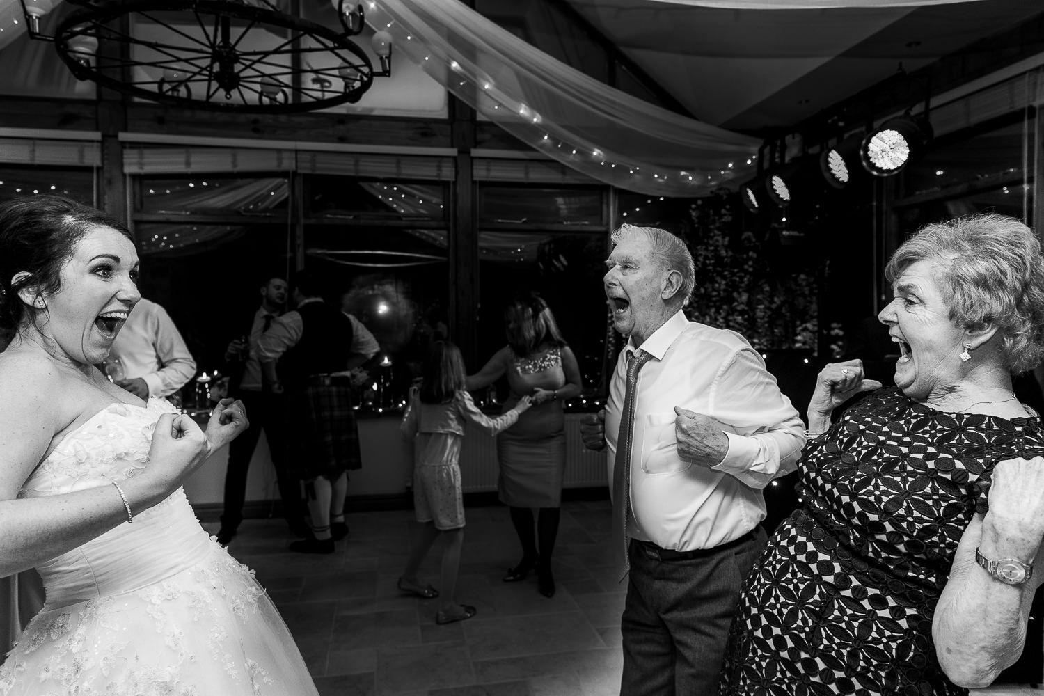 bride dancing with older guests