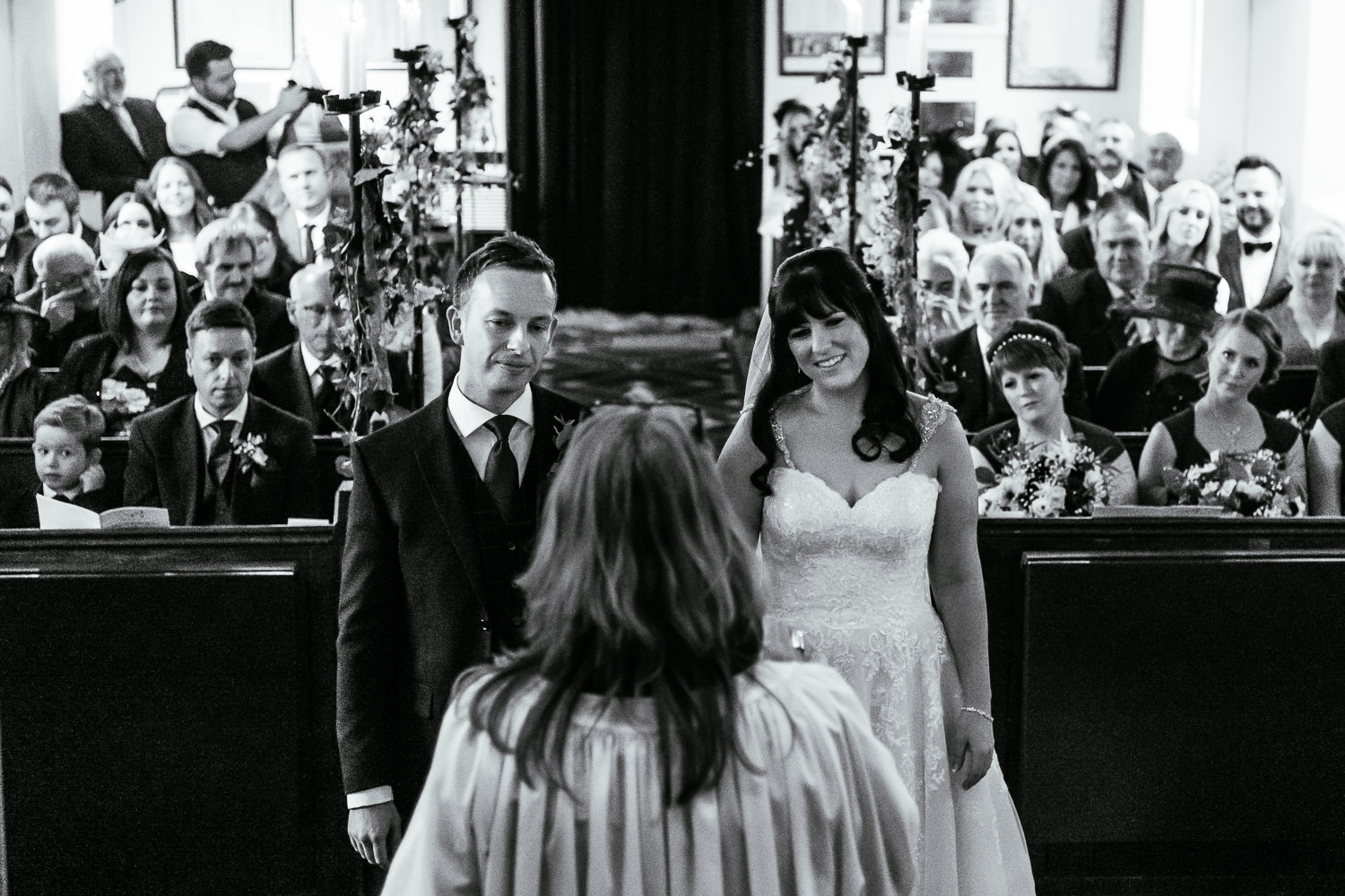 bride and groom saying vows in St Mary's church, Iscoyd
