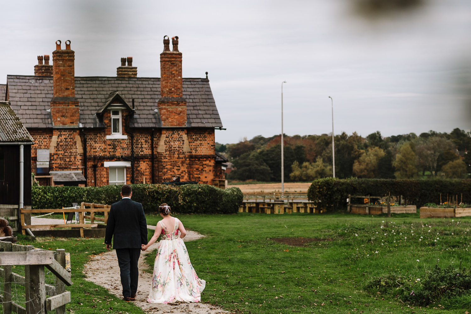 bride and groom walking towards Inglenook farm