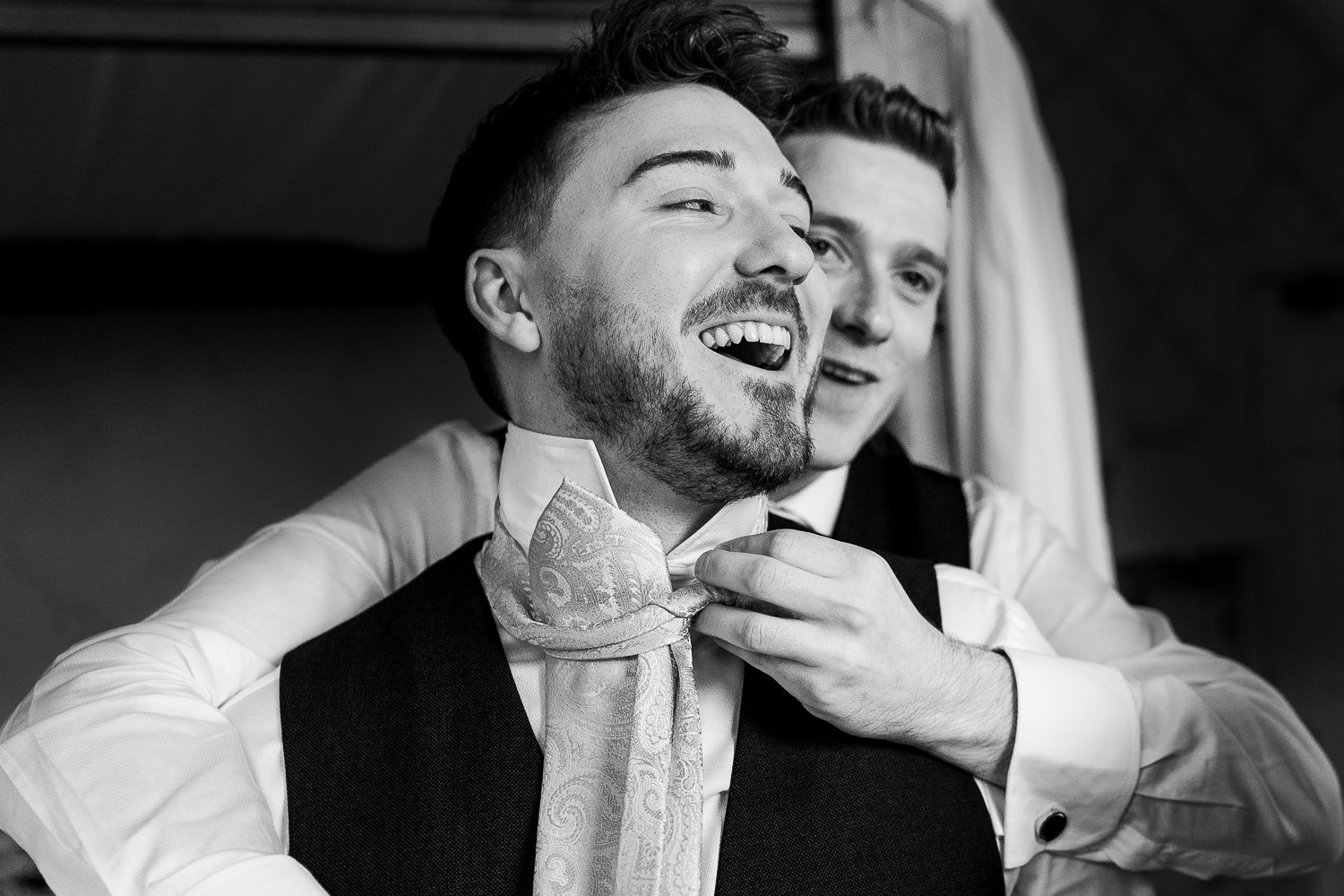 Groom doing tie for best man