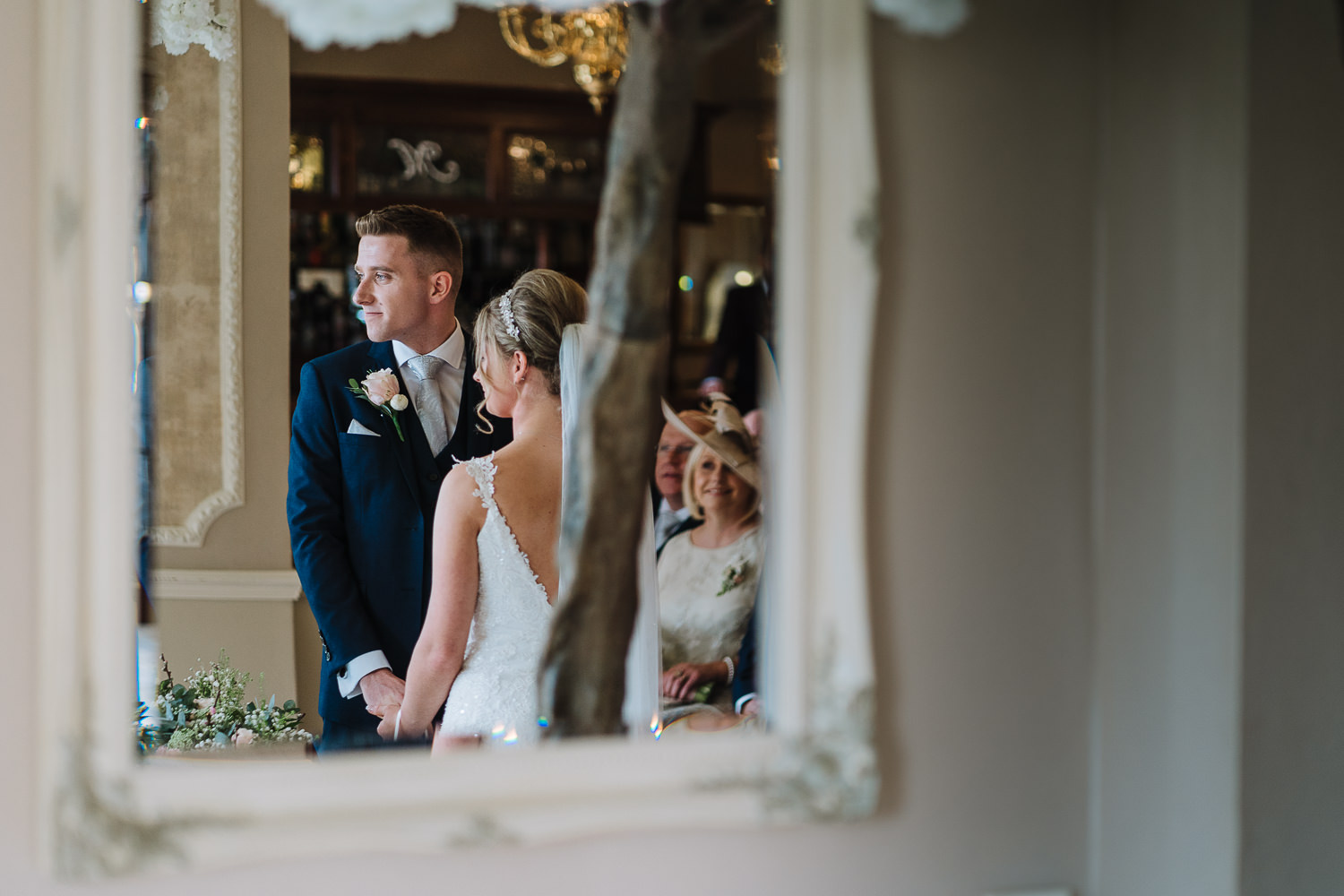 Photo of the bride and groom in the mirror