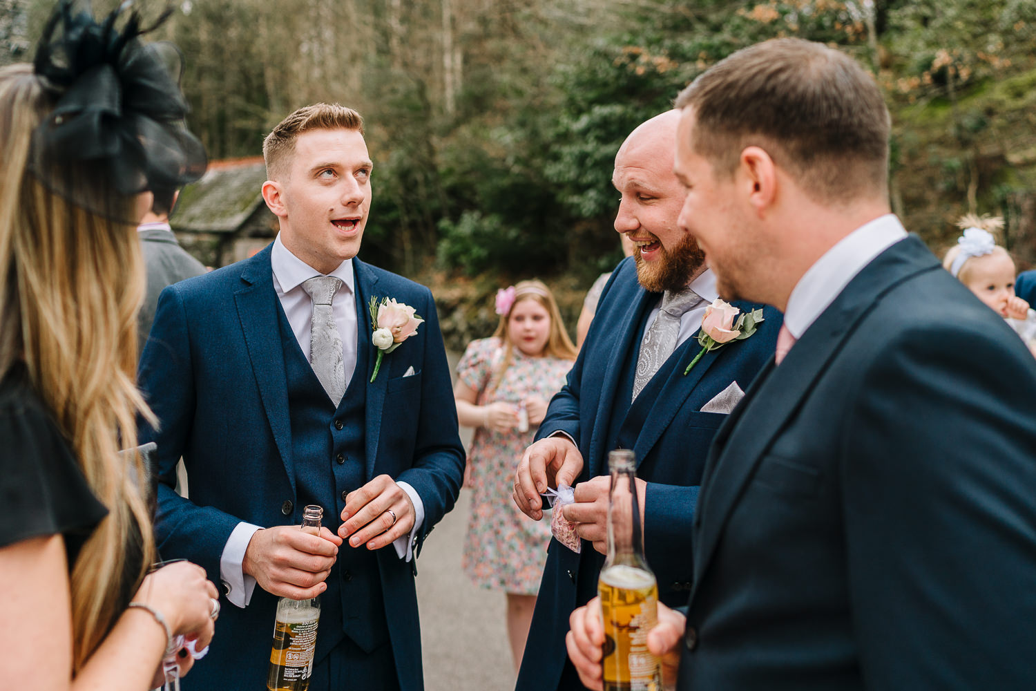 Groom pulling a face with groomsmen