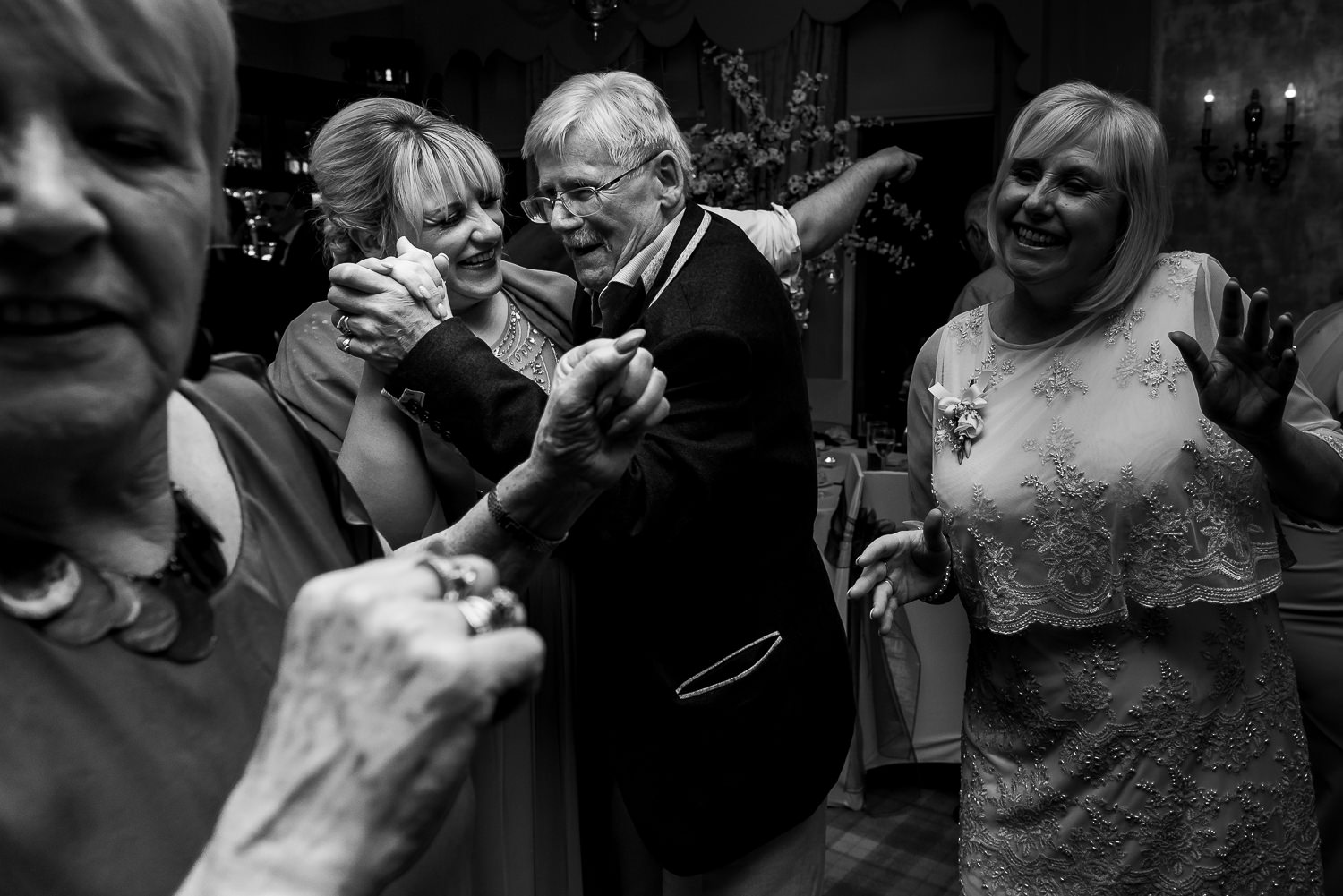 Granddad and granddaughter dancing