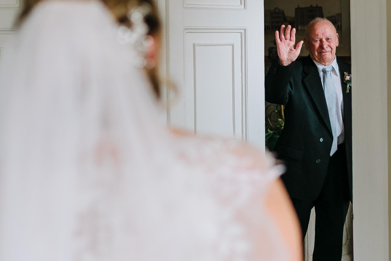 Grandad waving at bride