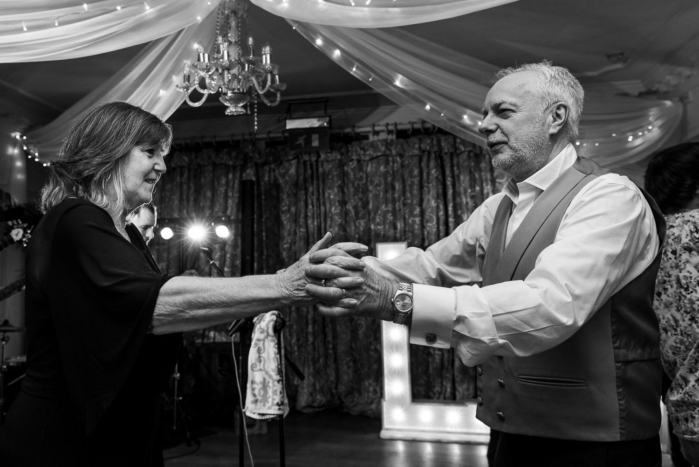 Grooms parents dancing