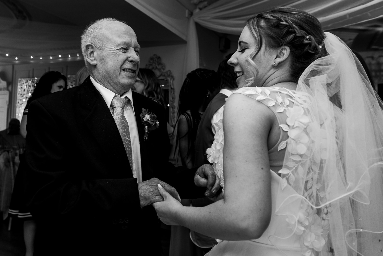 Bride dancing with her granddad