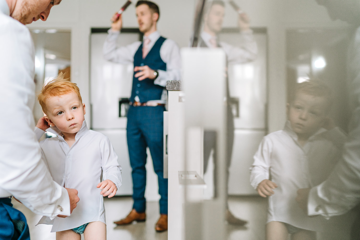 Groom getting ready with his page boy