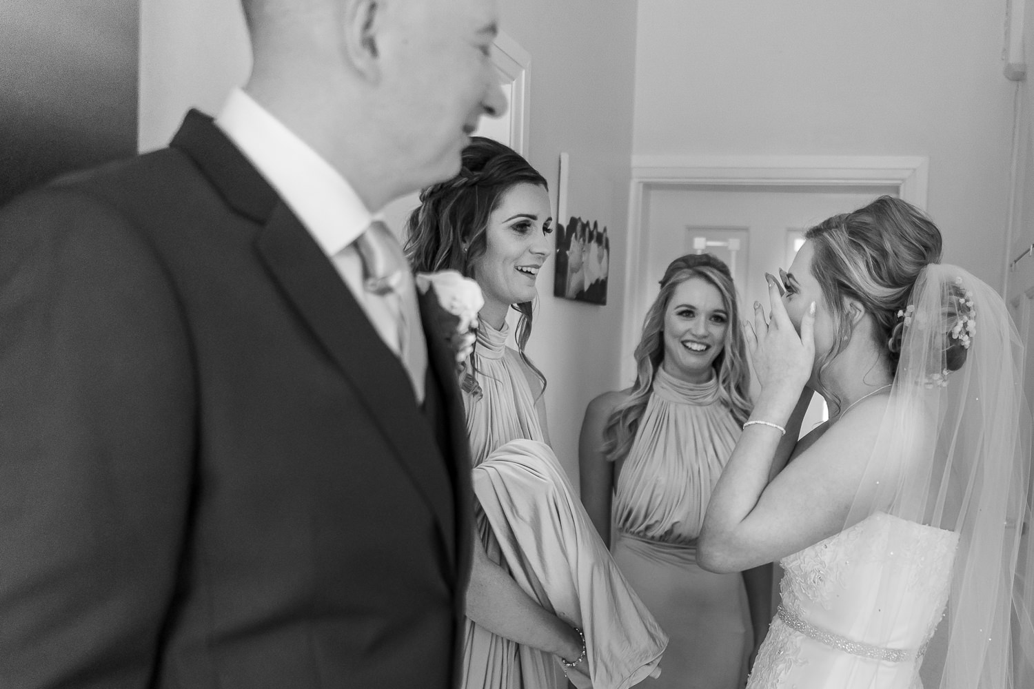 bride crying with family