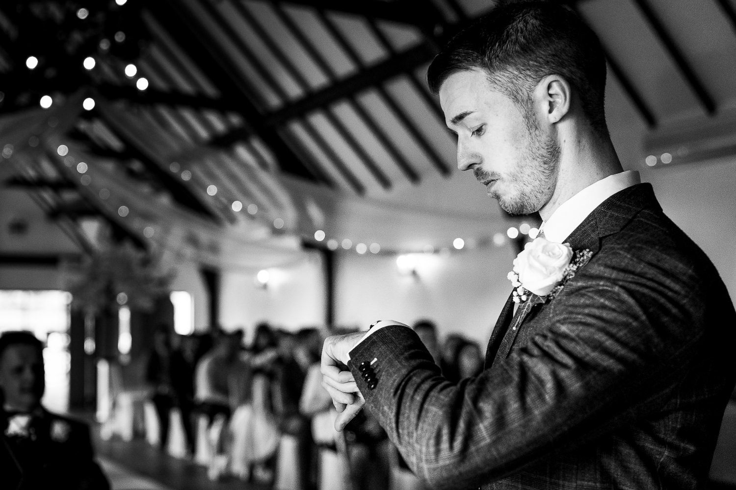 Groom checking the time