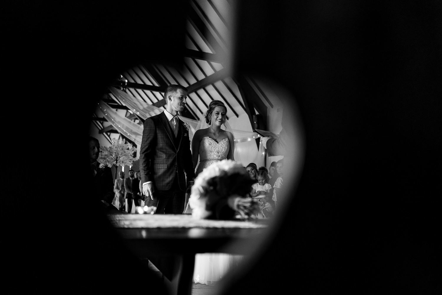 bride and groom through the chair