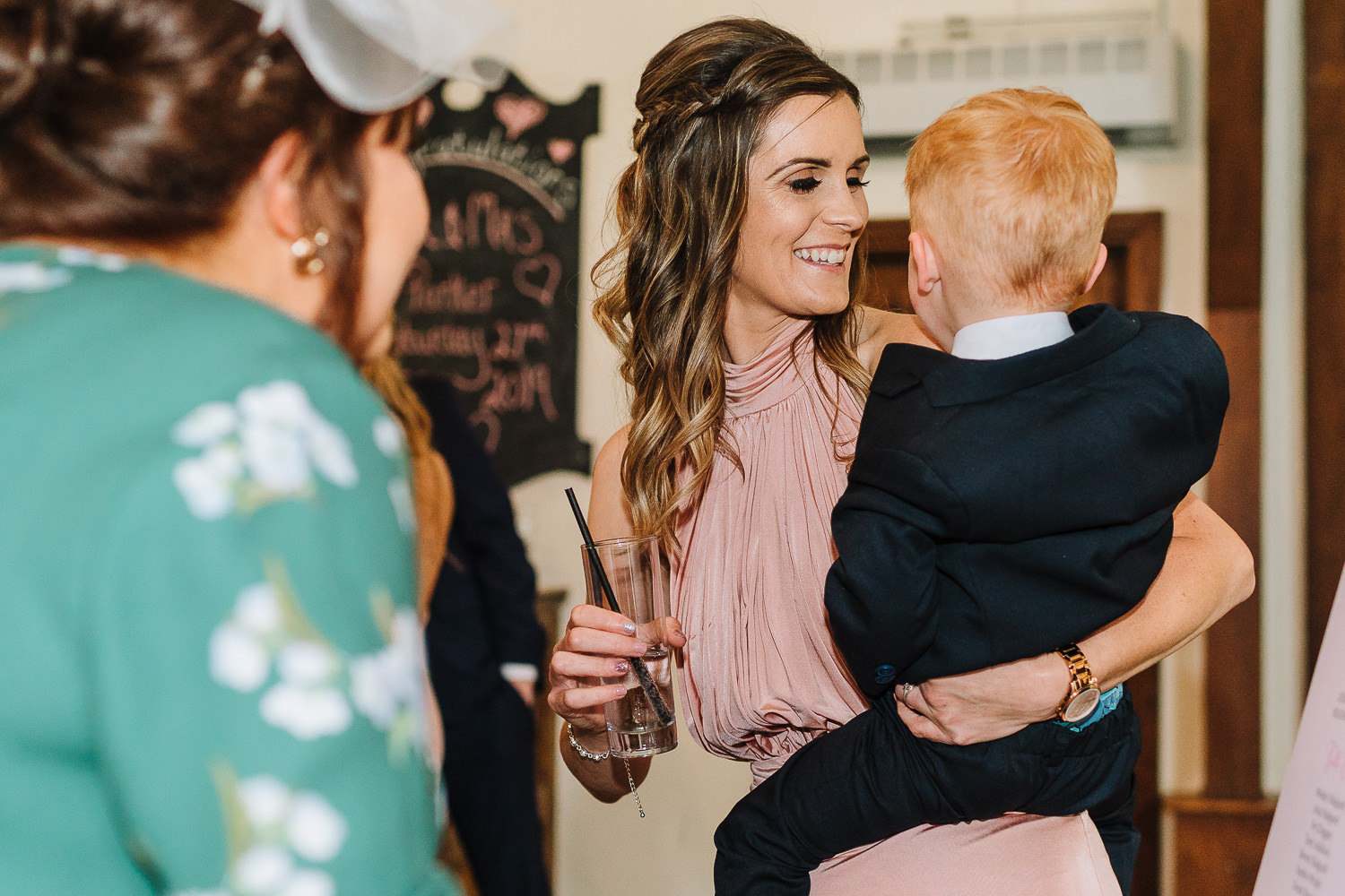 Bridesmaid laughing with her son