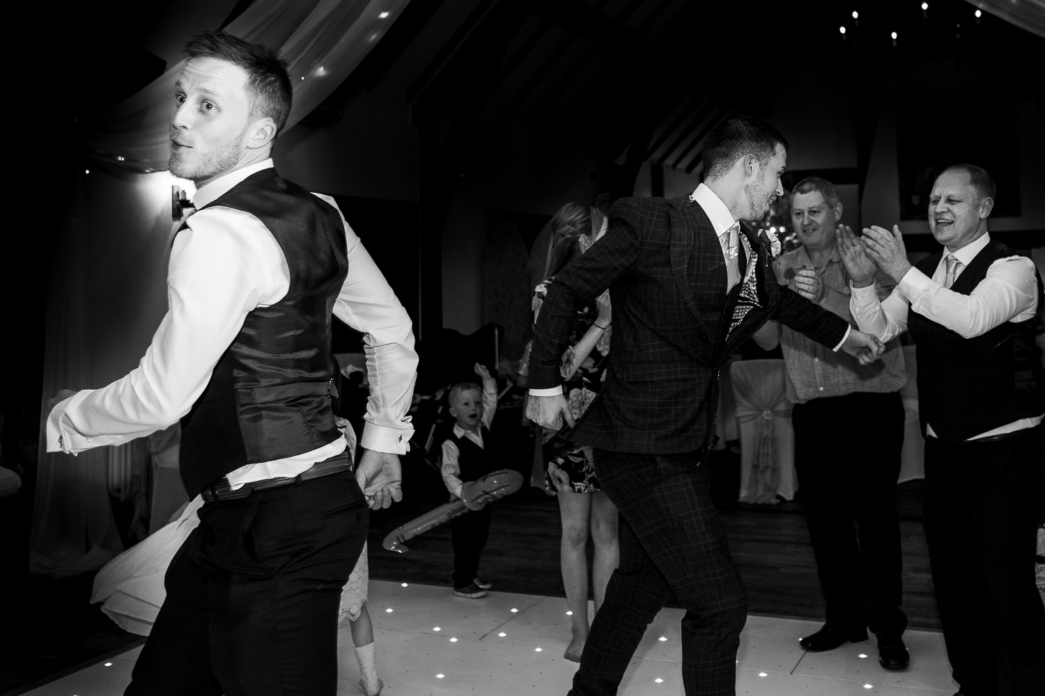 Groom and best man dancing