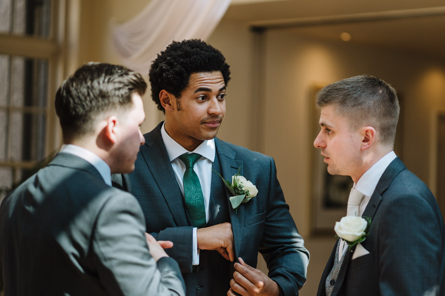 Groomsmen talking before service