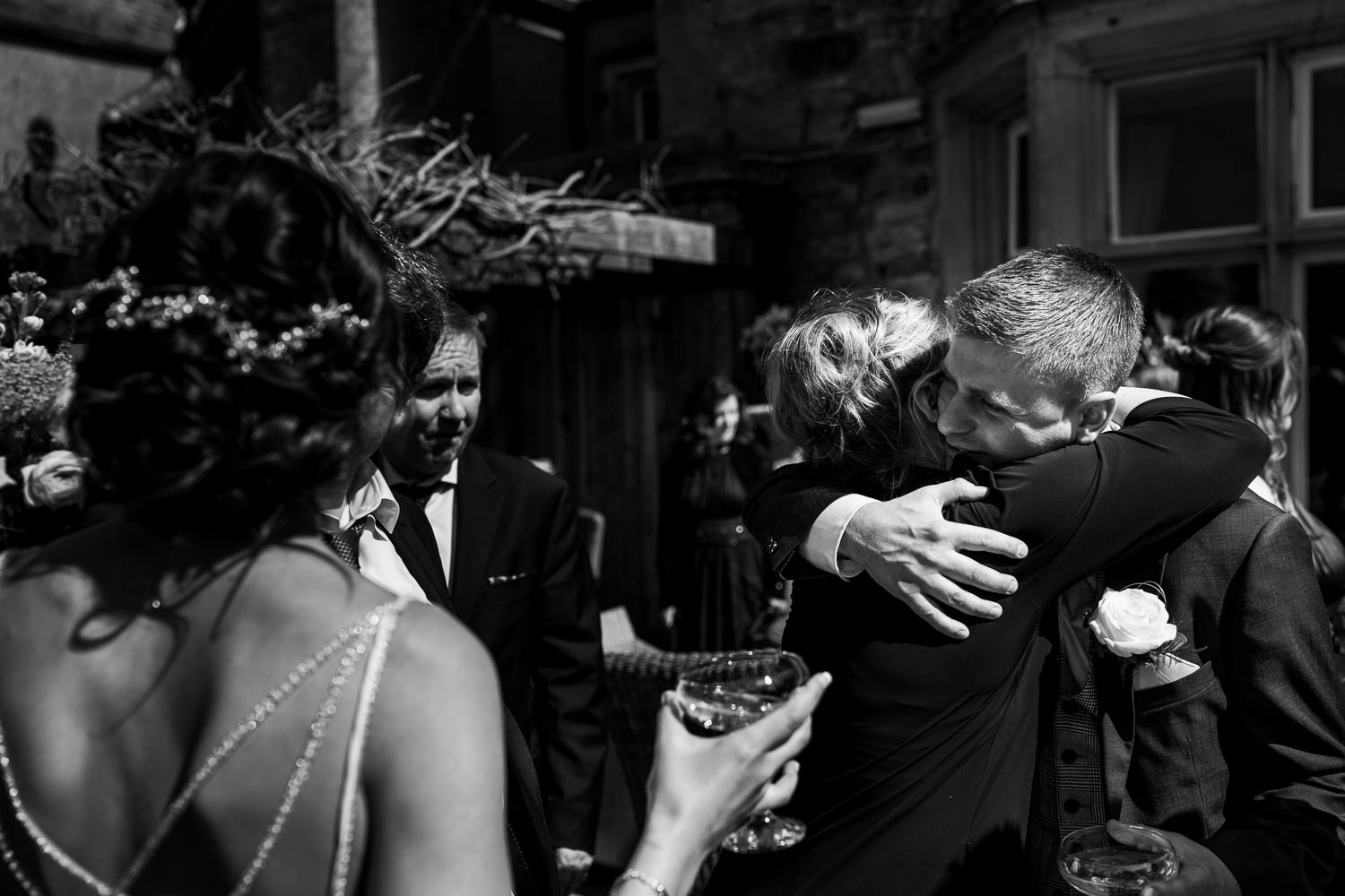 groom hugging a guest